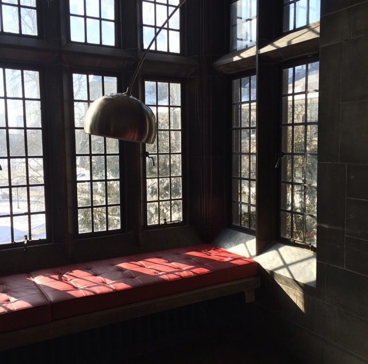 corner window seat with a lamp coming down at hart House library