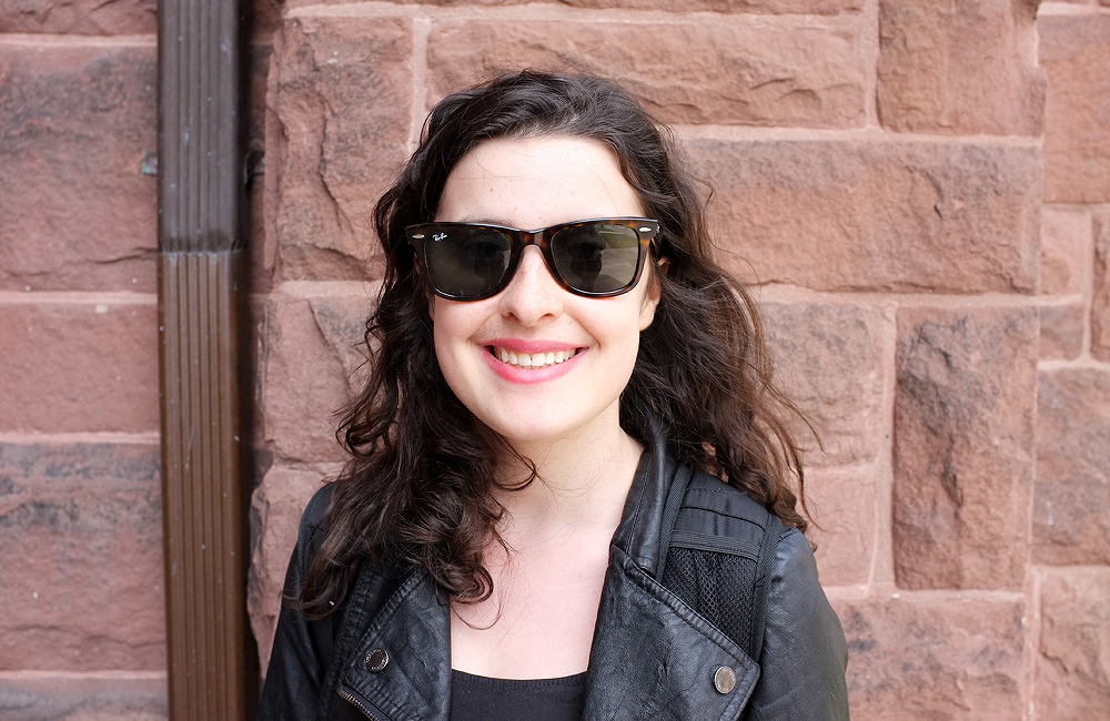 girl with sunglasses on poses for the camera