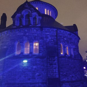 The round building on the west end of University College, with it's fancy stonework lit up in marvellous deep blue