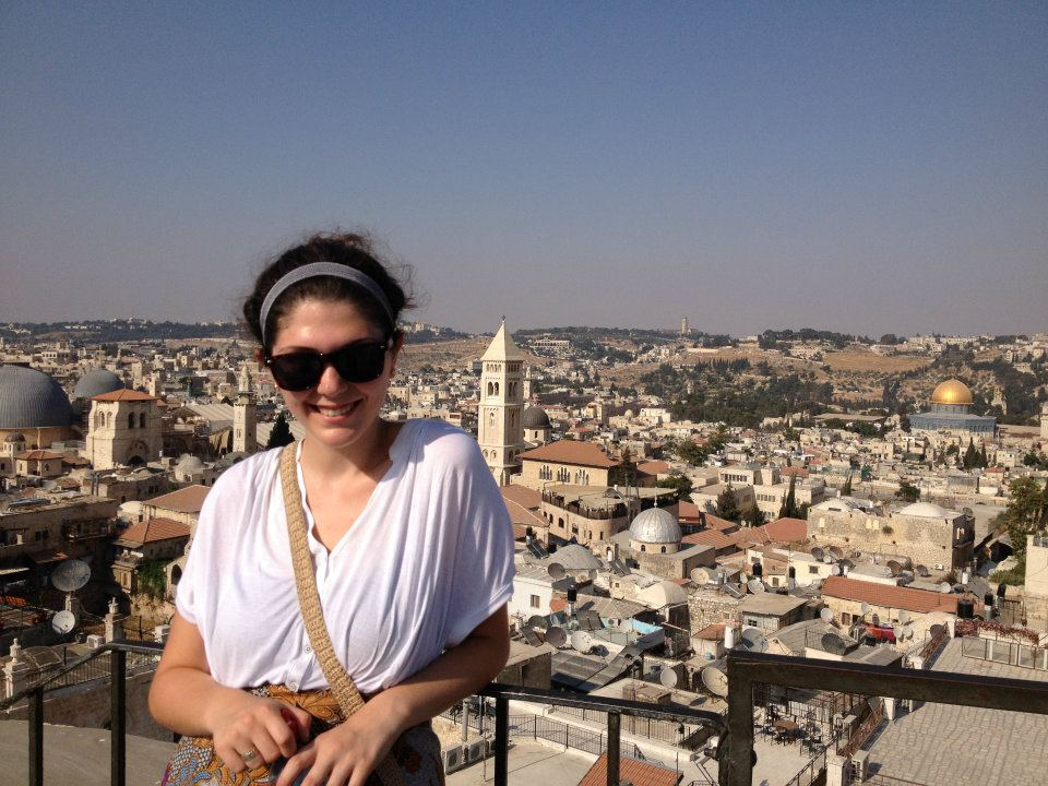 Me in Jerusalem against the backdrop of the city with the Dome of the Rock.