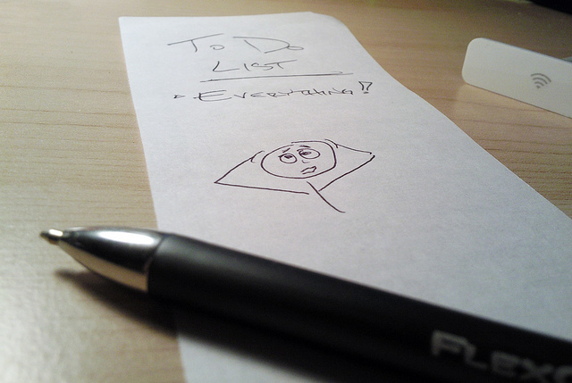 """Image of a pen and a to-do list with """"TO DO LIST"""" and the top, and the only item being """"Everything!"""" and a doodle of a stick man looking stressed."""