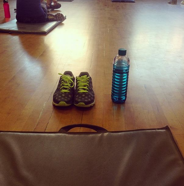 A yoga mat, shoes, and a water bottle at Hart House Fitness Centre in the Exercise room. I've been going to drop-in classes at Hart House as part of my goal to get fit.