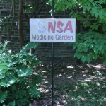 A sign for the Native Students' Association medicine garden