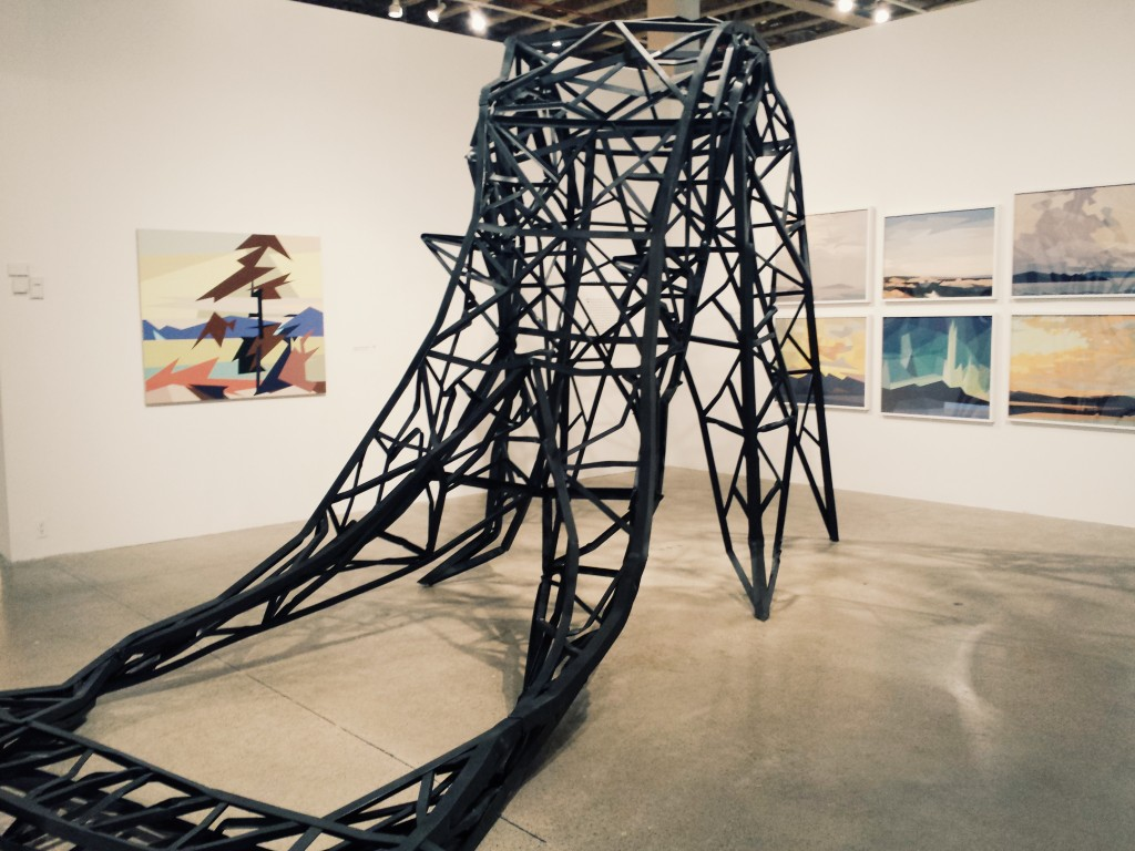 A huge metal installation shaped like a toppled-over electrical tower.