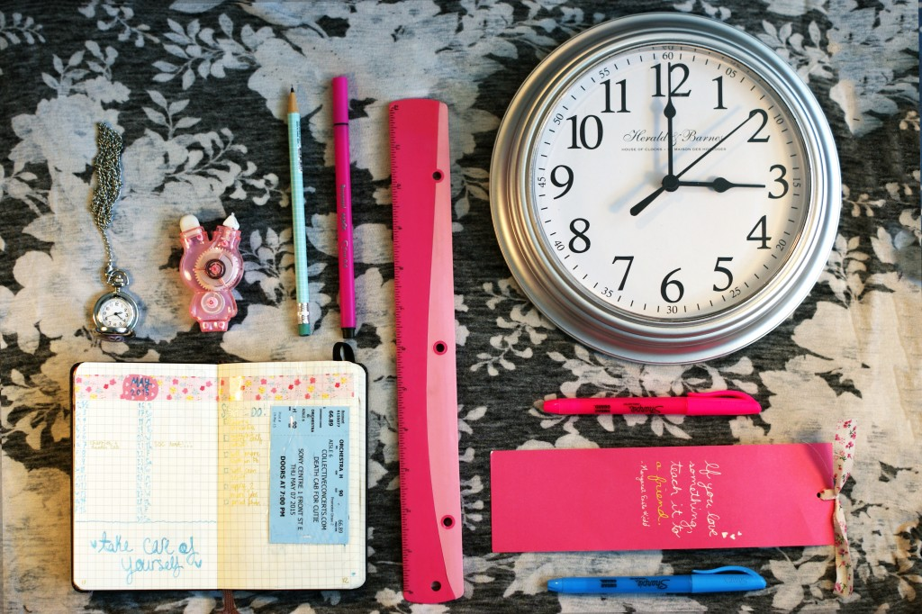 photo of: clock, writing utensils, bookmark, watch, and journal