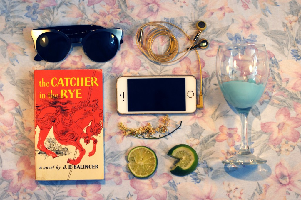 photo of: sunglasses, book, iphone, earphones, limes, and wine glass