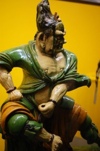 photo of an ancient asian porcelain sculpture