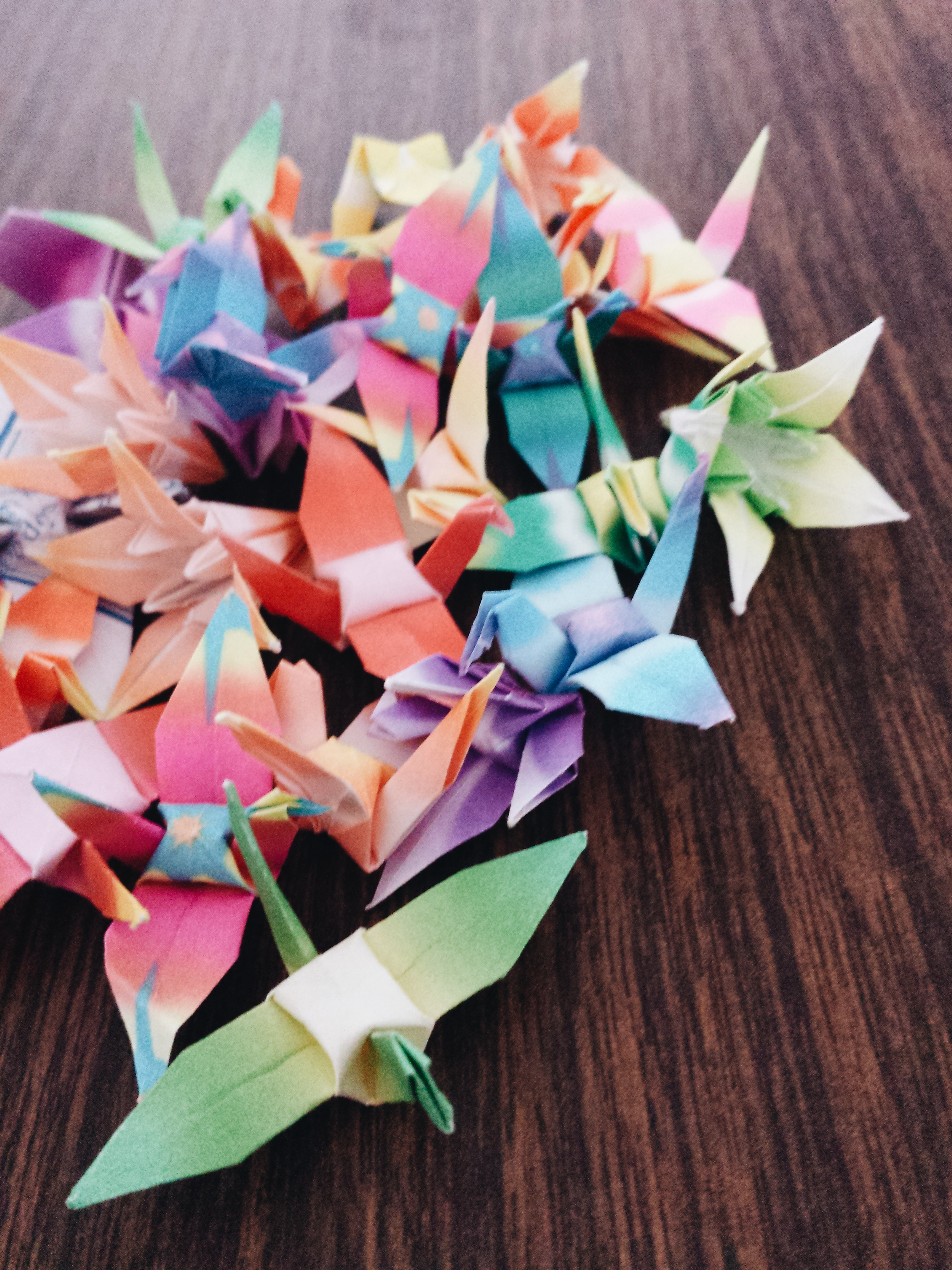 Colourful origami cranes and flowers