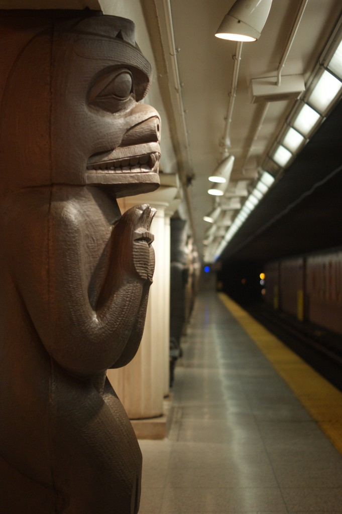 photo of the museum subway station, featuring one of the many totem poles that decorate it