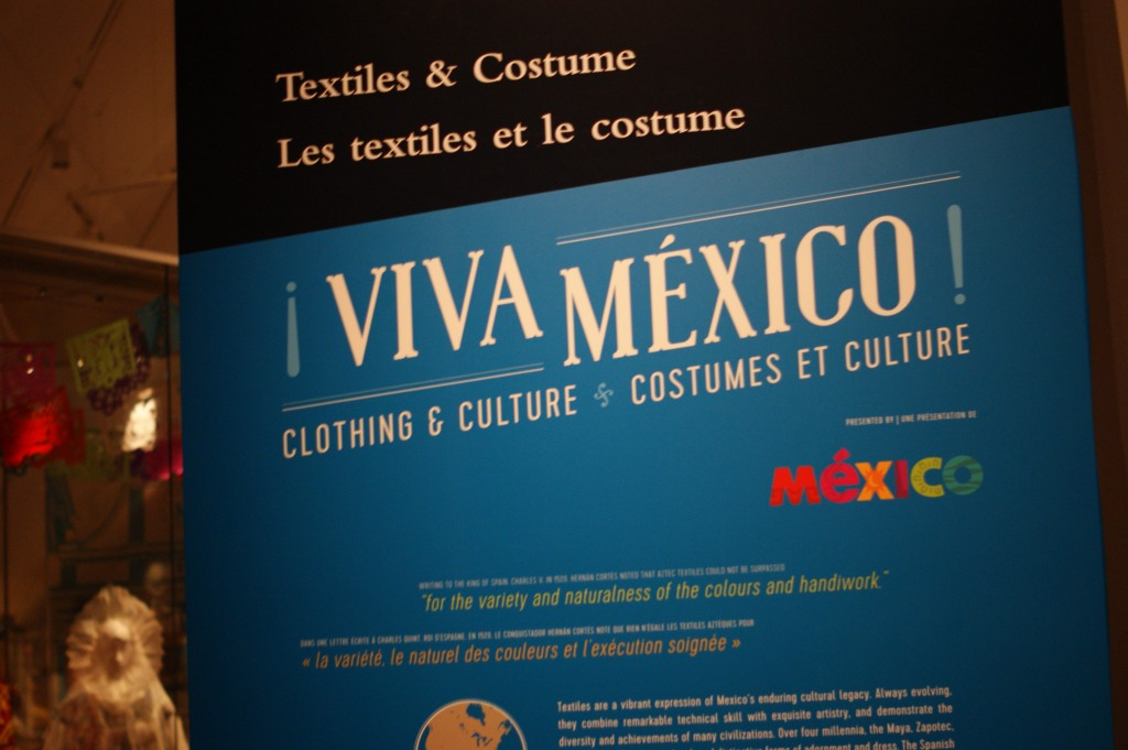 photo of a sign that reads: Textiles and Costume: Viva Mexico! Clothing and Culture