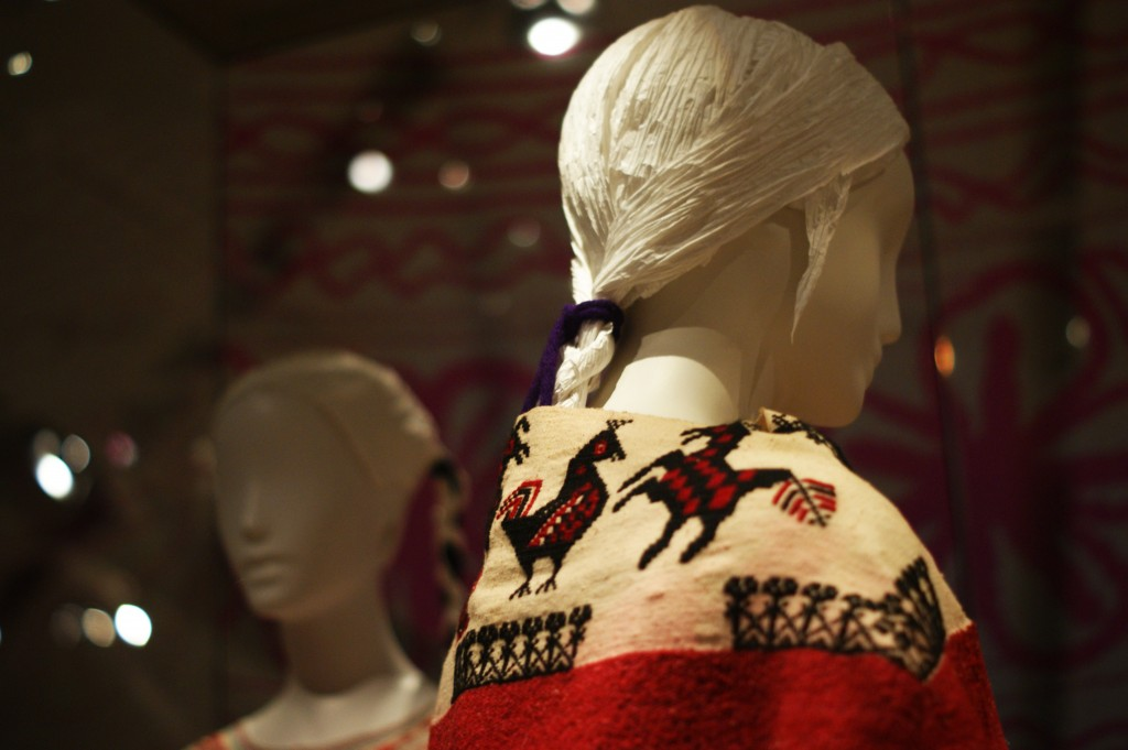 a mannequin wearing a traditional mexican shawl