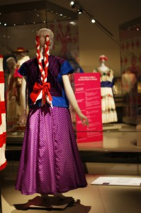 a mannequin wearing traditional mexican dress, featuring a bright purple polkadot skirt