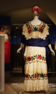 a mannequin wearing traditional mexican dress, featuring lace and roses