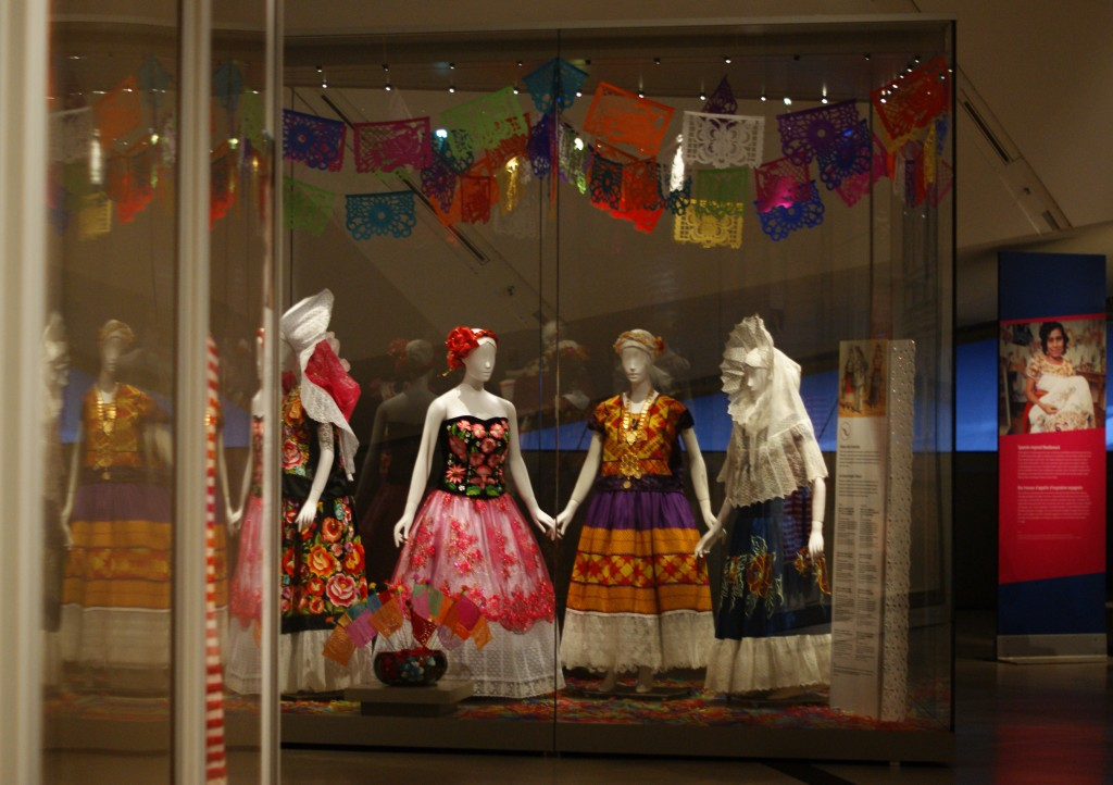 four mannequins wearing traditional mexican dress