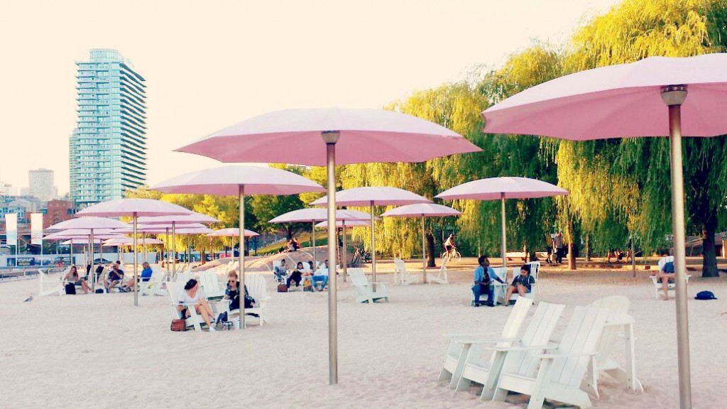people and Pink umbrellas on Sugar Beach