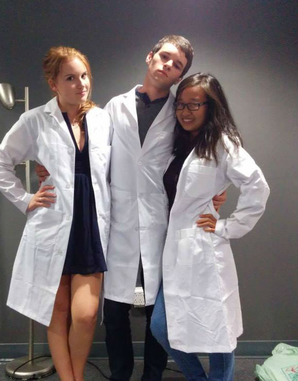 A picture of Madeline, and her two life science friends in new lab coats!