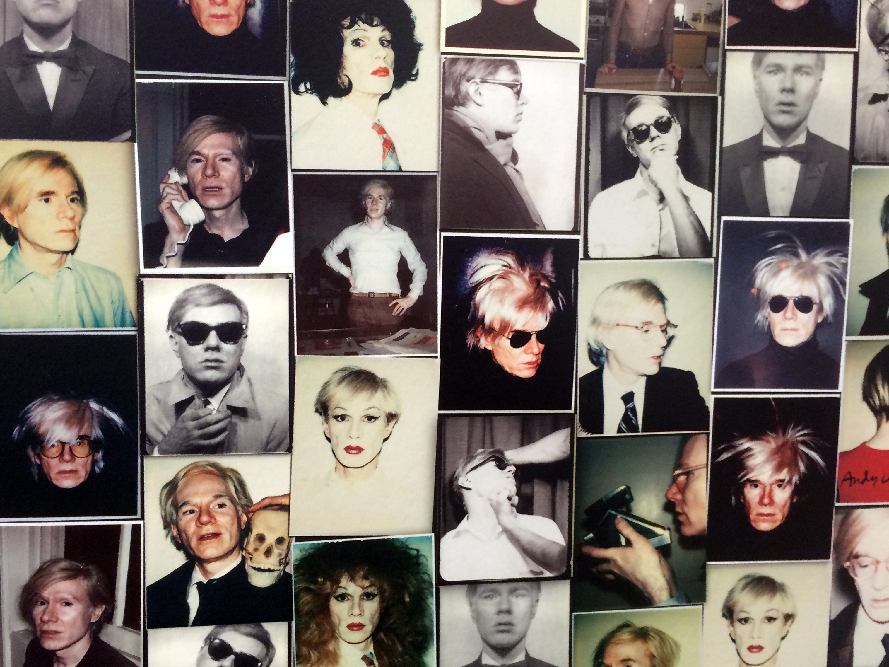 wall covered with photos of andy warhol