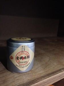 A can of Oolong tea on an empty shelf.