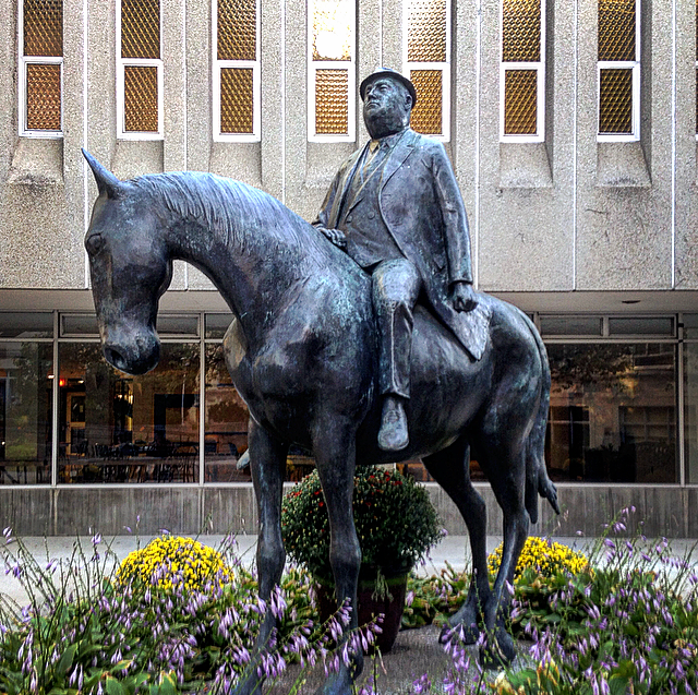 statue of a portly businessman on a horse