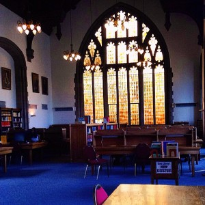 knox college library with orange stained glass window in background