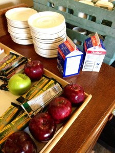 photo of tray of apples, granola bars and milk cartons