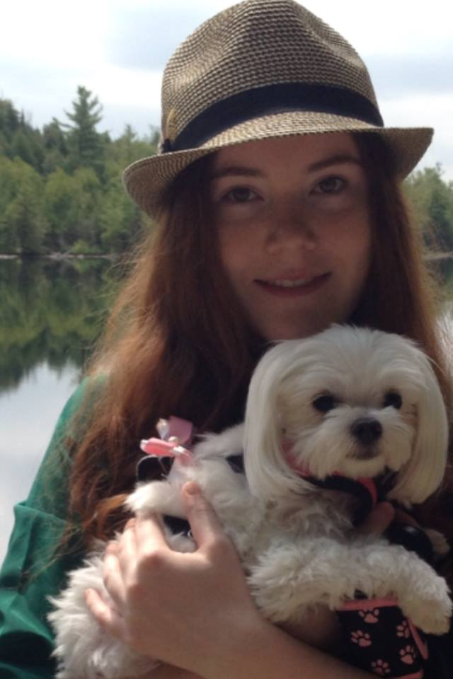 A picture of new blogger, Emma Smith, standing by a lake with her dog