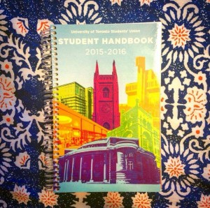photo of colourful UTSU agenda resting on obnoxiously bright patterned bedsheet