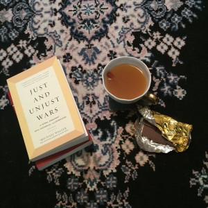 Pictured: a book, a mug of hot apple cider, and a bar of chocolate