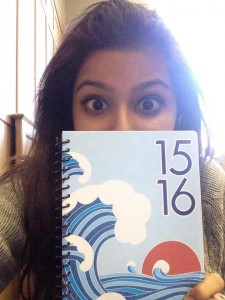 a photo of me holding up my planner aka the one thing i cannot live without