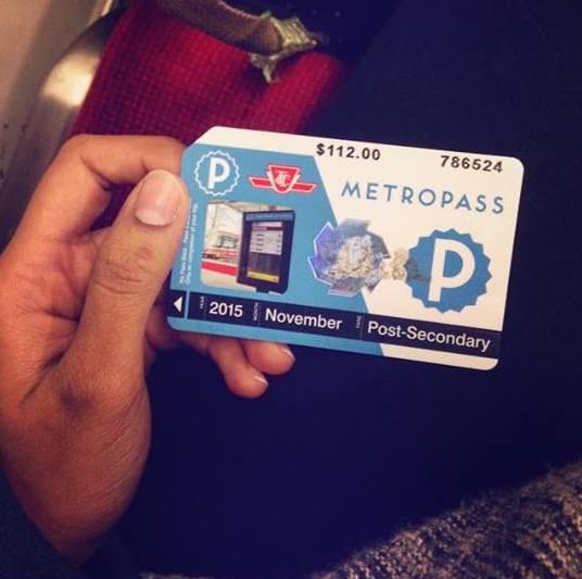 hand holding up a metropass