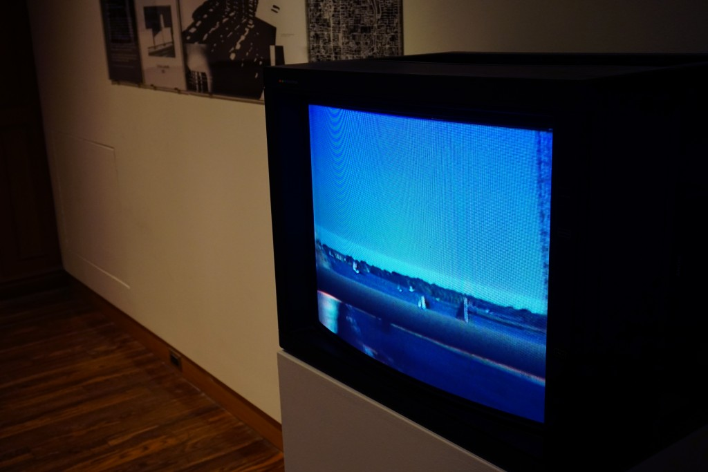 a retro TV set playing a video of the toronto landscape
