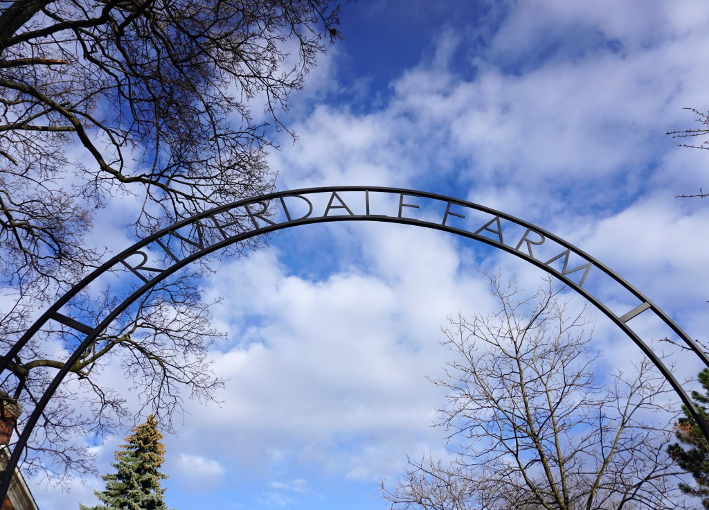 photo of the riverdale farm sign against the sky
