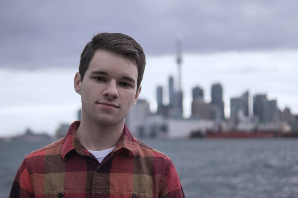 Logan with a backdrop of the Toronto skyline.