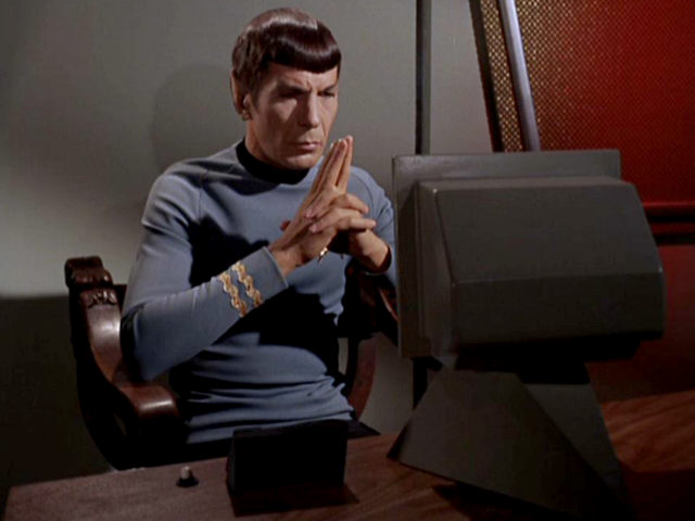 Pictured: Spock from Star Trek staring at a computer