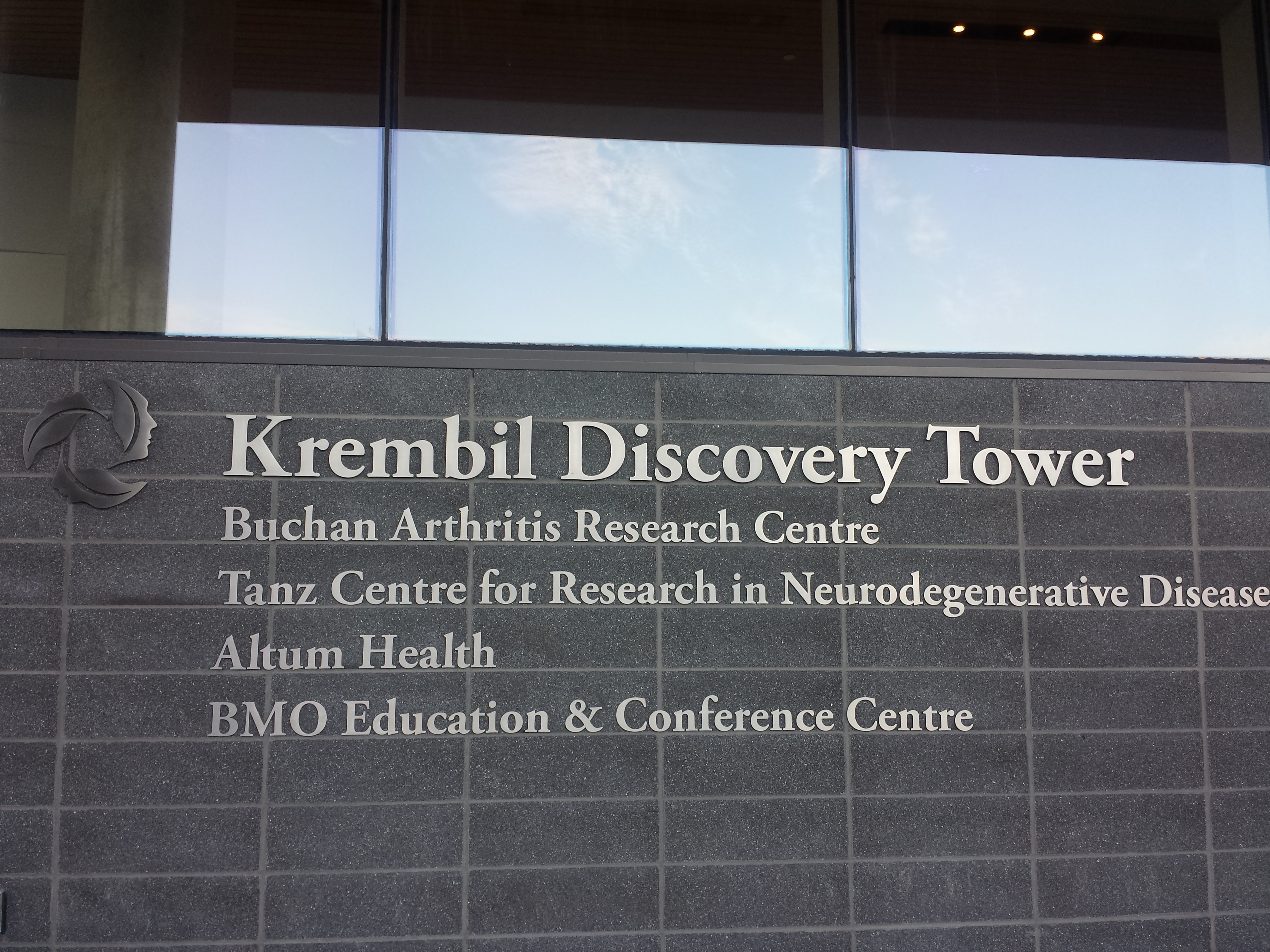 The sign in front of the Krembil Discovery Tower including the different research centres inside.