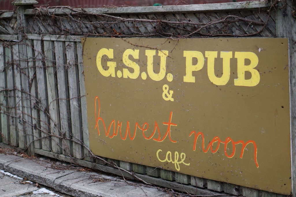 "photo of a sign reading ""G.S.U. Pub & harvest noon cafe"""