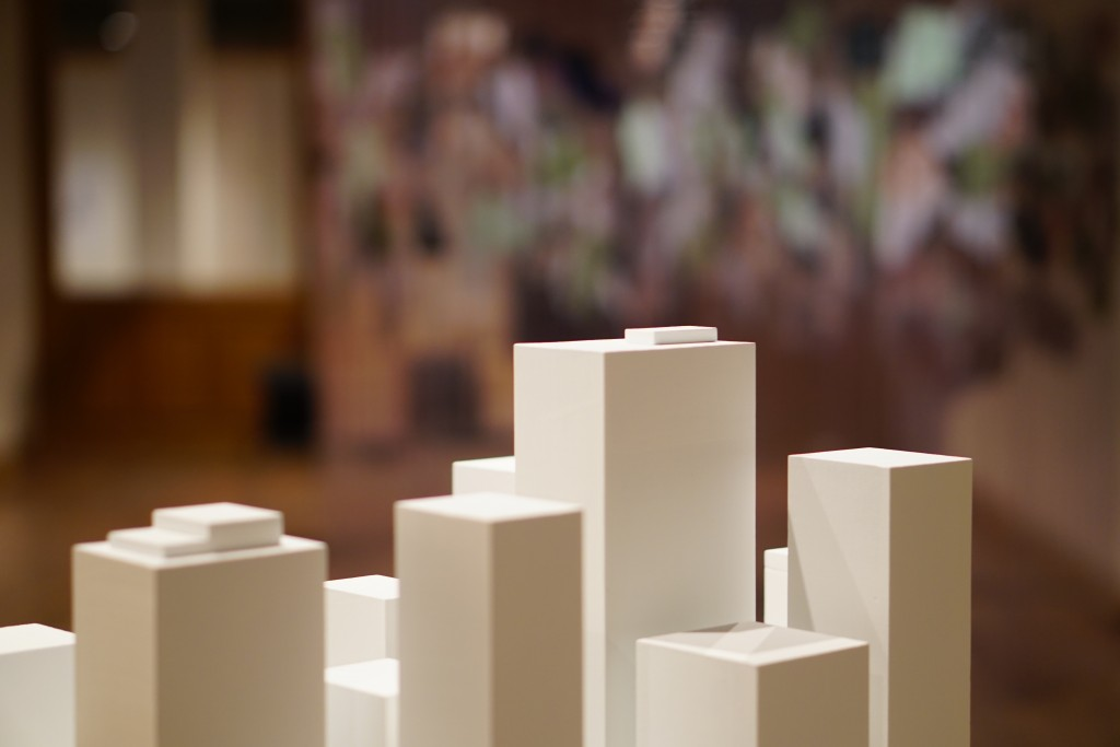 architectural models of buildings against a blurred background