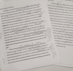 Two of my essay drafts; the one in front is scrawled with my essay edits, while the other in the back is filled with feedback from the Writing Centre staff!