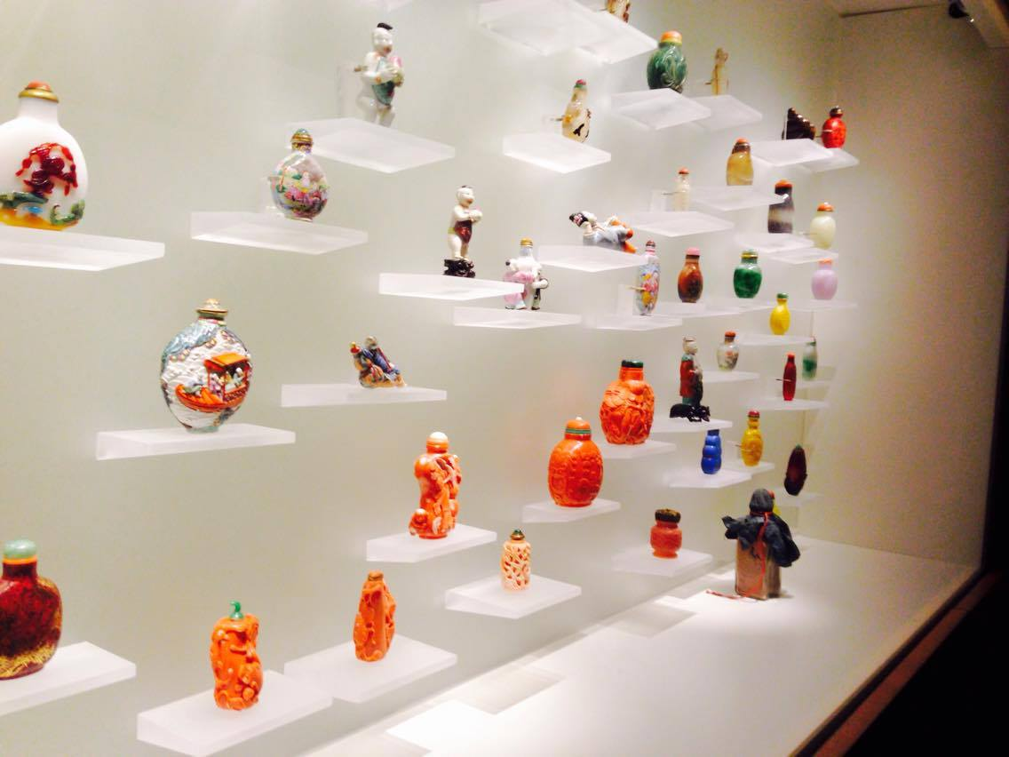 Very small and tiny glass bottles that are delicately painted to be very colourful.