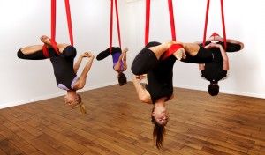 This is aerial yoga. 10/10 would recommend. Even if just for the awesome Instagram photos you'll get out of it. Source: yearningforyoga.wordpress.com