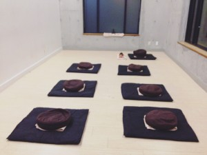 The meditation room with cushions laid out in two lines.