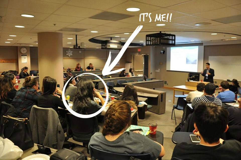 A lecture hall filled with students listening to a guest speaker.