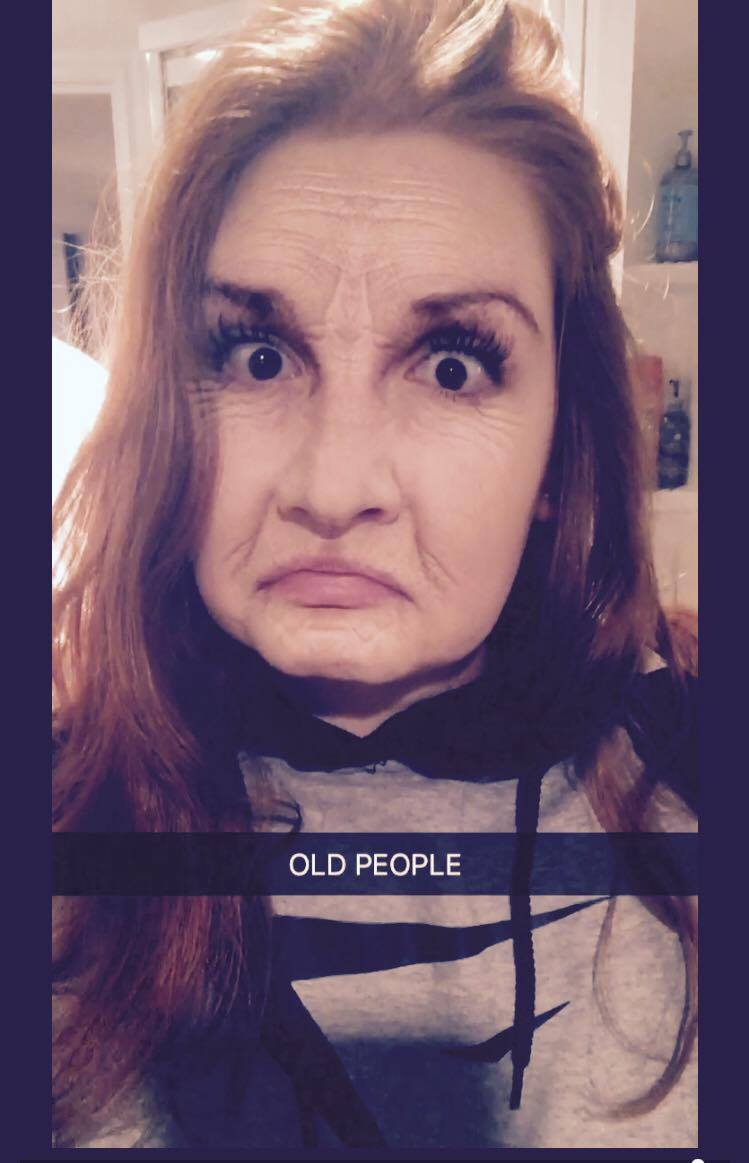 A snapchat of Madeline with the old/wrinkly filter over her face. She looks displeased.