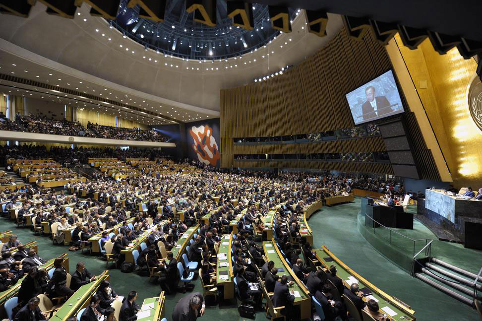The UN General Assembly Hall filled with world leaders and national delegates.