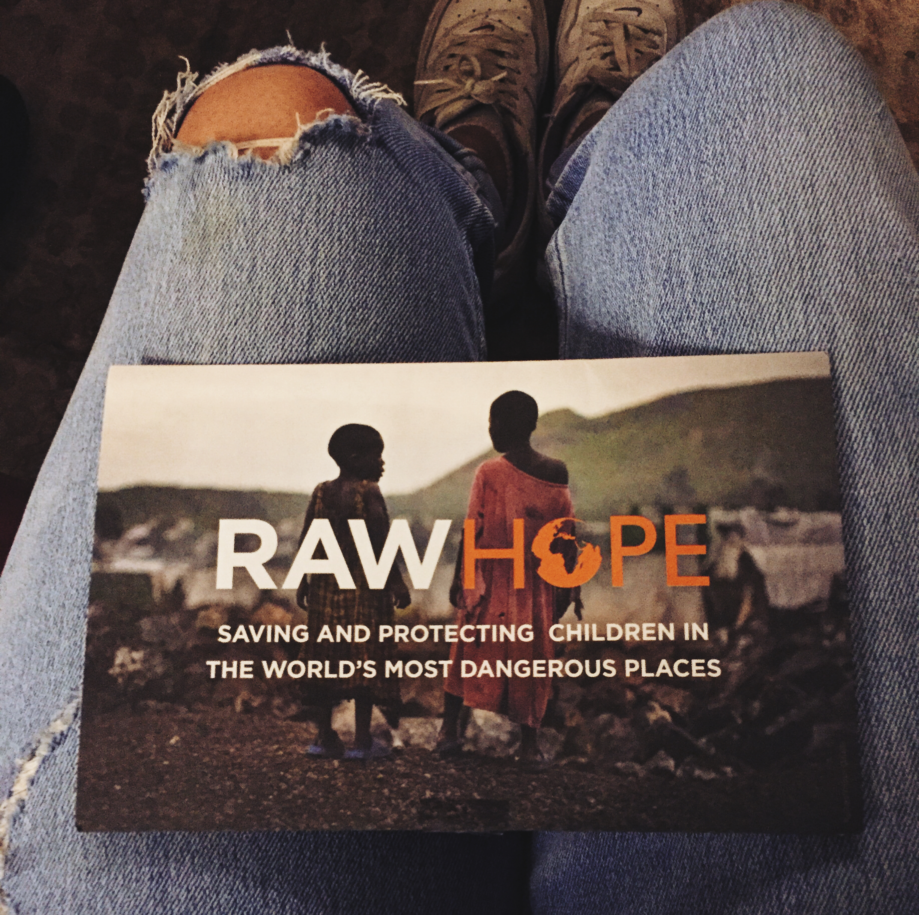 The Raw Hope flyer/donation card on my lap.