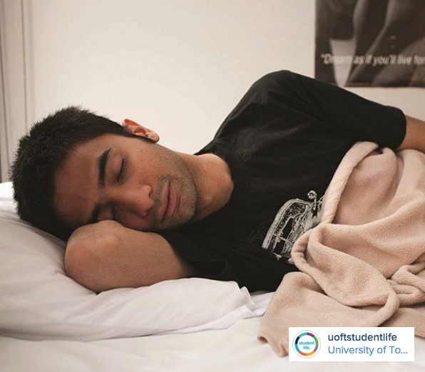 A student napping happily in bed