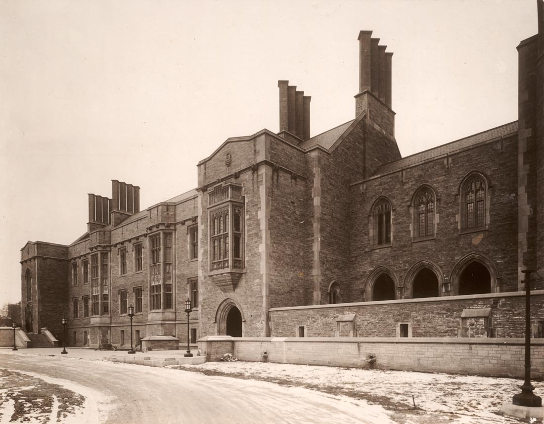 A view of the front of Hart House in a sepia photograph with some snow on the ground.