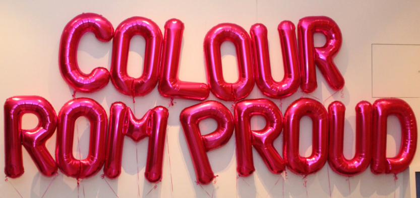 Sign made of balloon that reads Colour ROM Proud