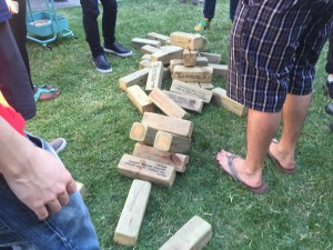 picture of giant jenga blocks toppled over