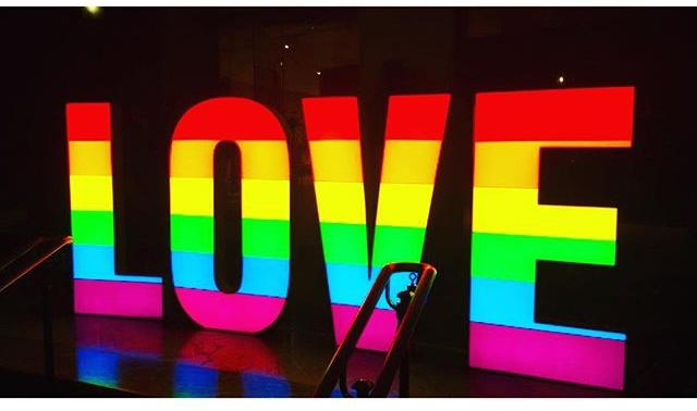Coloured marquee that reads LOVE